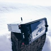 Insane Audio Product JK2001 on a log in the snow
